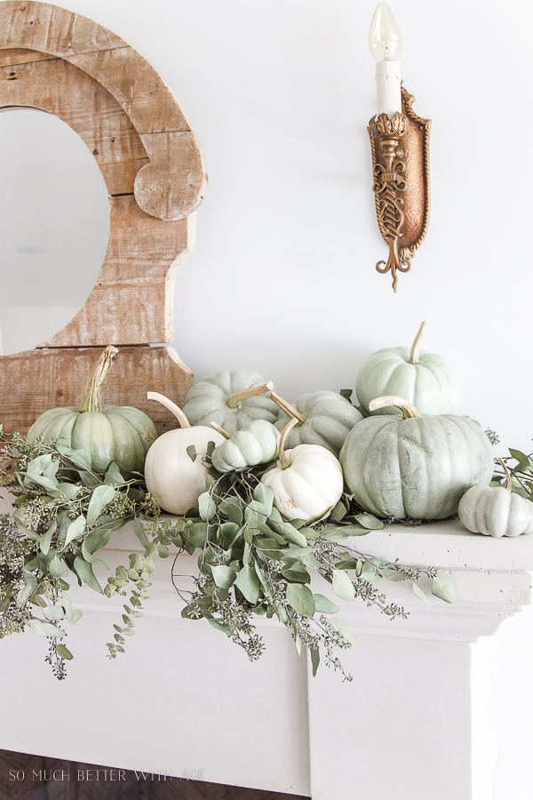 DIY heirloom pumpkin tutorial /rustic mirror, wall sconce and heirloom pumpkins on mantel - So Much Better With Age