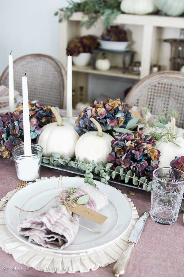 French Fall Home Tour with Purple and Green / Purple hydrangeas, purple French linen tablecloth, white pumpkins, seeded eucalyptus - So Much Better With Age