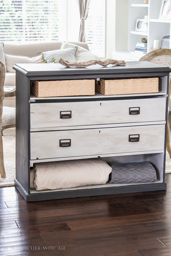 Grey painted dresser with open drawers.