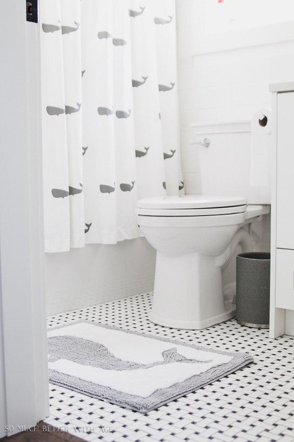 Simple clean and white kids bathroom reveal / black and white tile - So Much Better