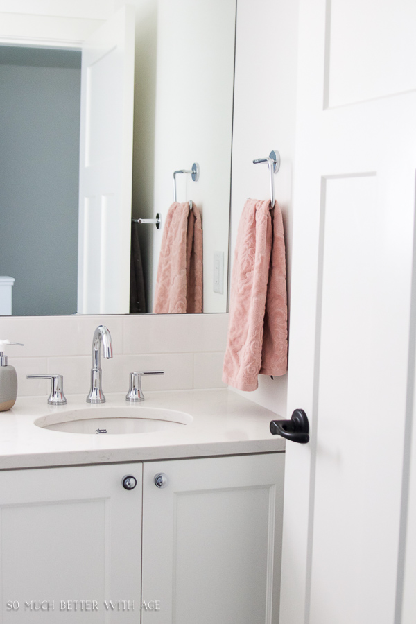 Simple clean and white kids bathroom reveal / pink towels - So Much Better With Age