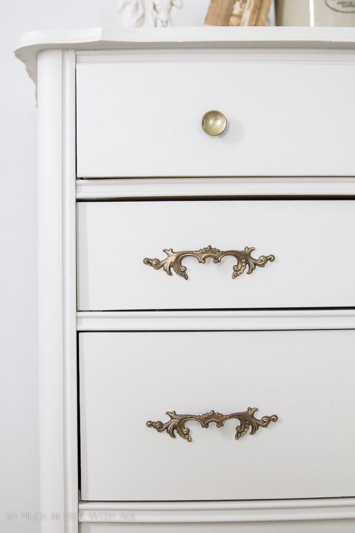 8 Steps on How to Finish Badly Damaged Furniture /  white painted dresser with vintage gold handles - So Much Better With Age