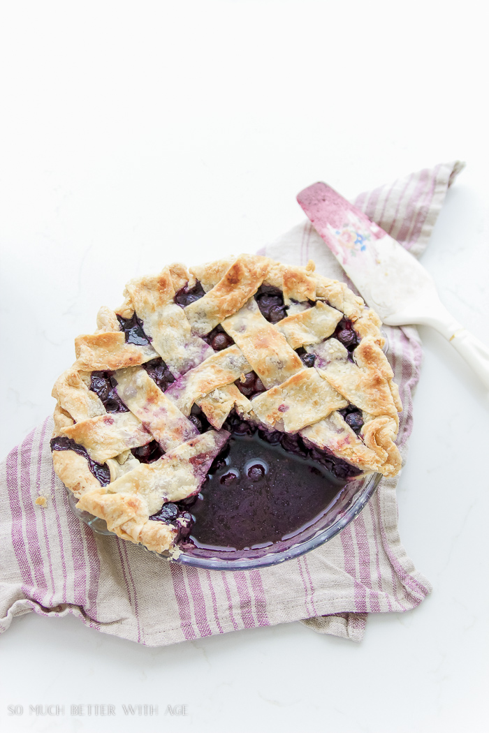 Best blueberry pie recipe / pie on table with pie server - So Much Better With Age