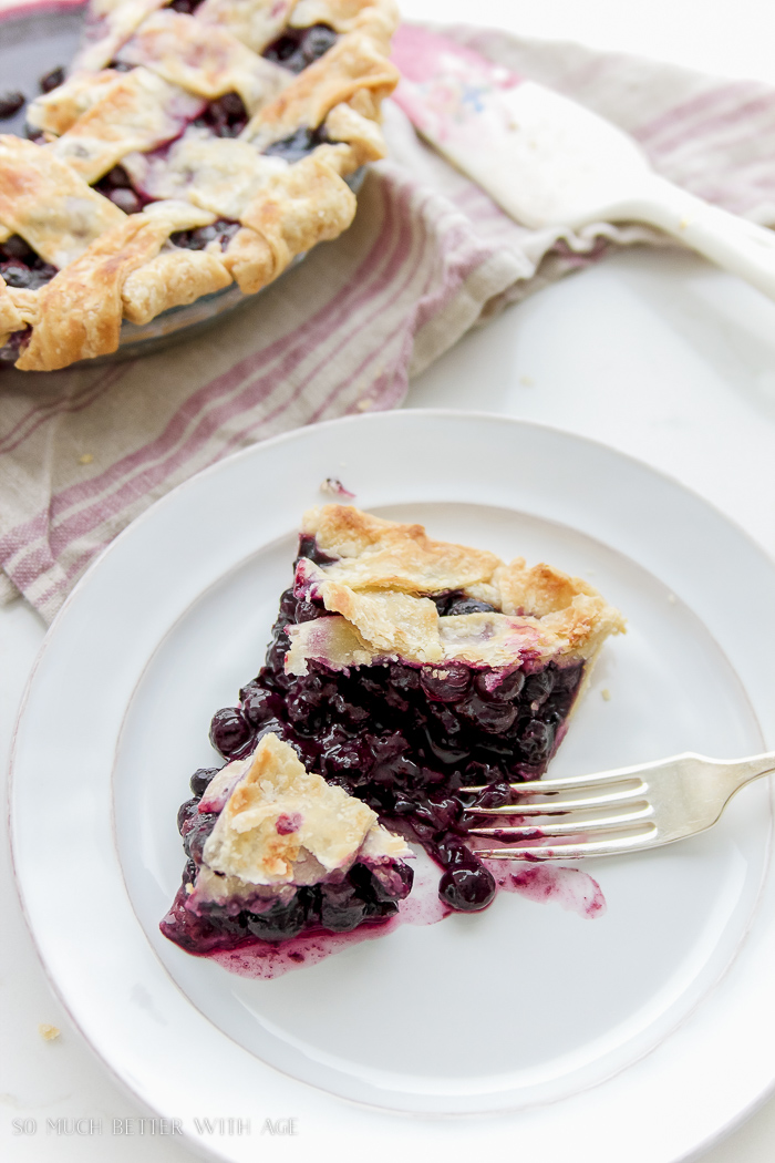 Best blueberry pie recipe / pie slice on plate - So Much Better With Age