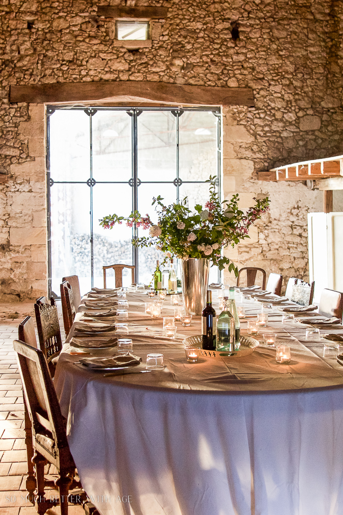 An old French barn with a table set for dinner.