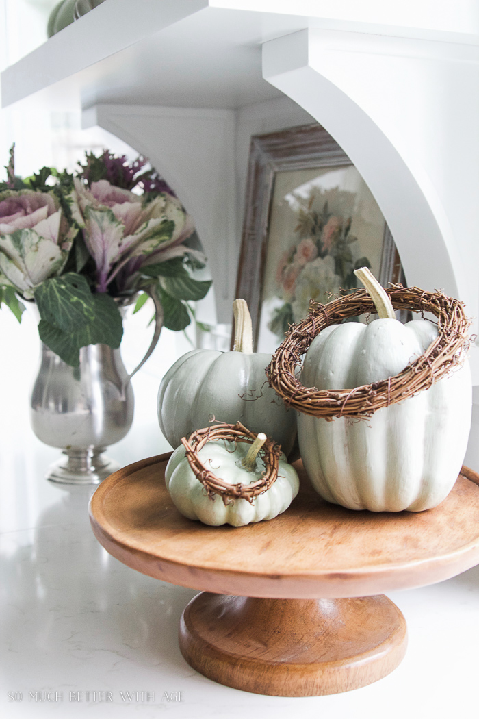 heirloom pumpkins on cake stand with kale flowers- Fall Kitchen Tour