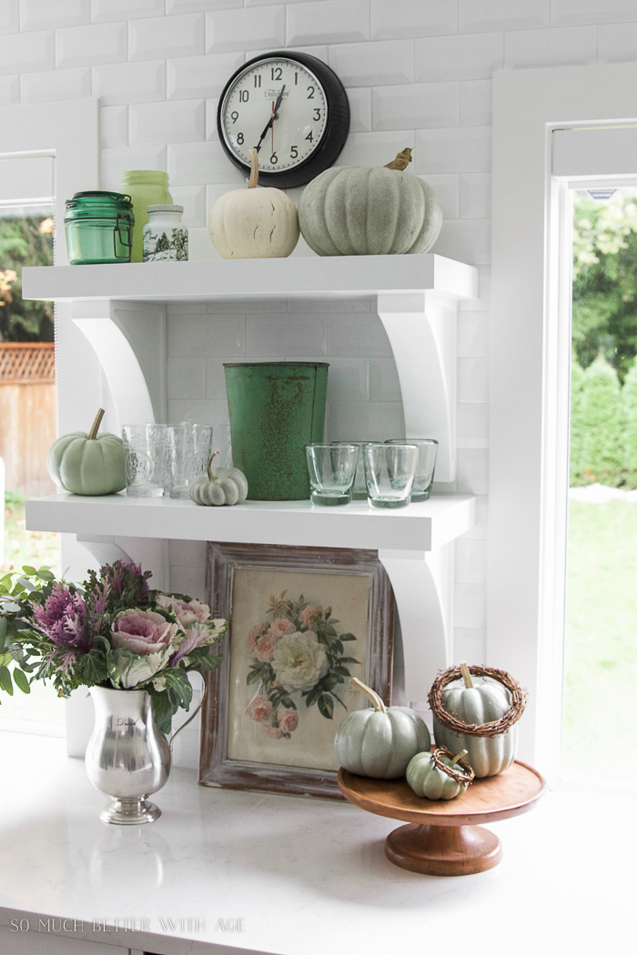white shelves in white kitchen green decor- Fall Kitchen Tour