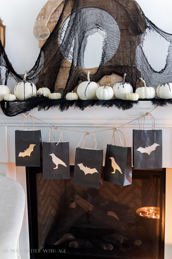 white pumpkins, bats, crows - Classic black Halloween mantel decor