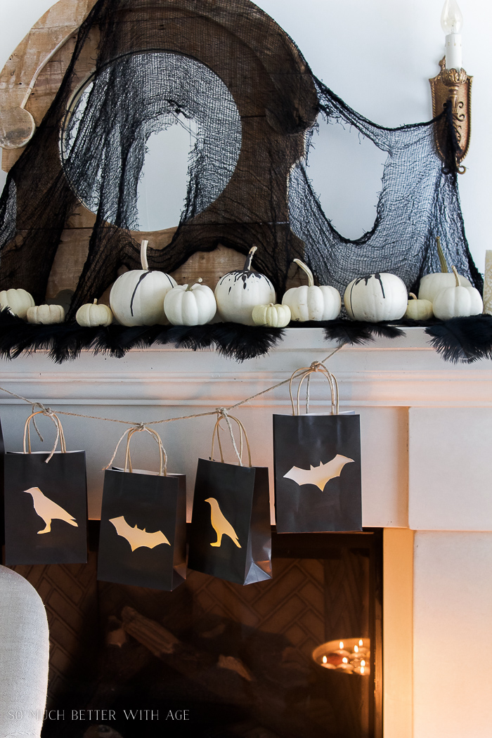 Ostrich feathers, white pumpkins- Classic black Halloween mantel decor