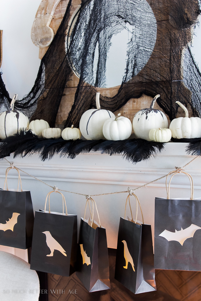 Lantern bags, wax dripped pumpkins- Classic black Halloween mantel decor