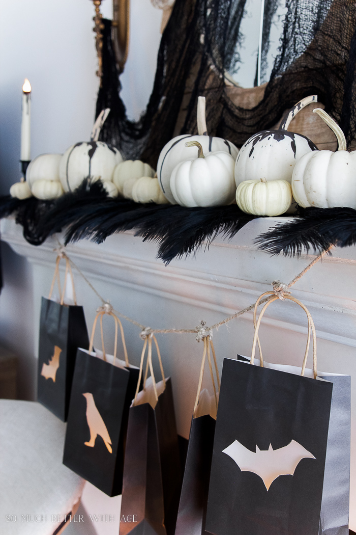 White pumpkins, black decor for Halloween- Classic black Halloween mantel decor