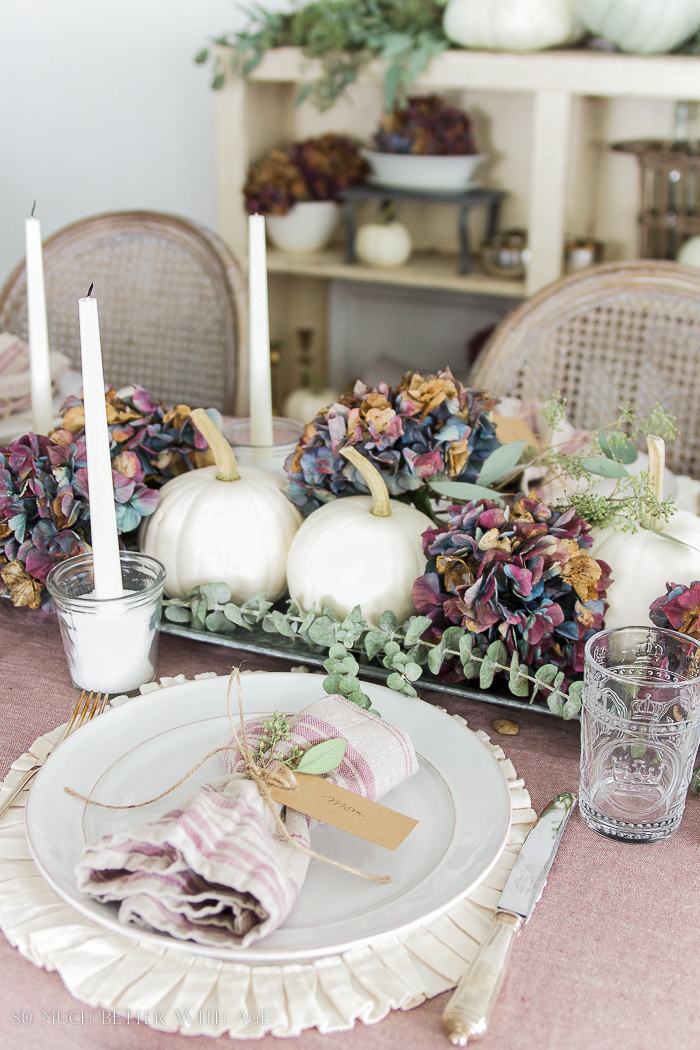 white pumpkins, hydrangeas, ruffled placemats- French yogurt jar candles
