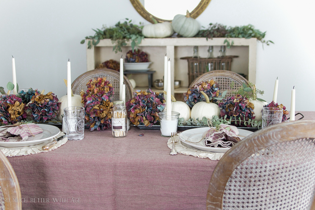 French yogurt jar candles / hydrangeas and white pumpkins linen tablecloth - So Much Better With Age