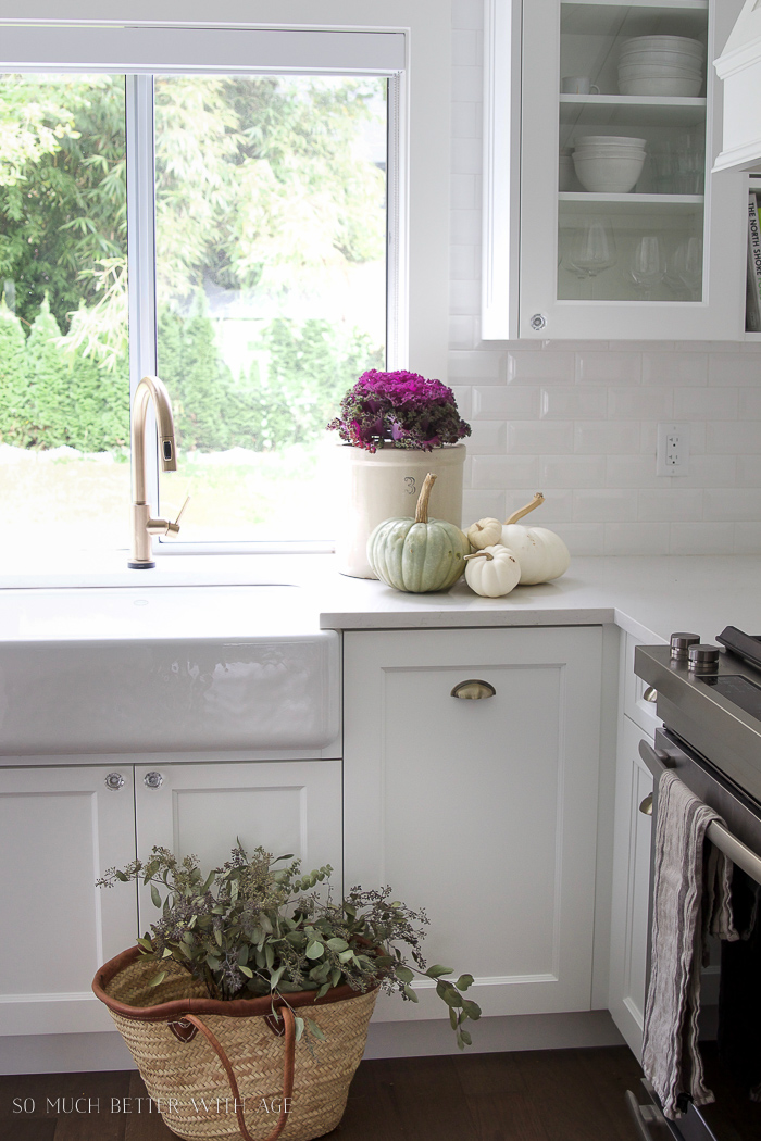 White vintage kitchen, kale plant, white pumpkins, french basket- Fall Kitchen Tour