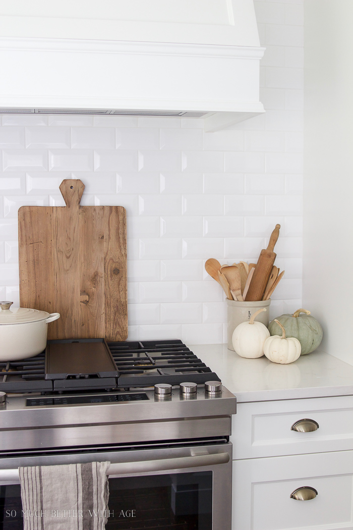 White kitchen, subway tile, range hood, pumpkins - Fall Kitchen Tour