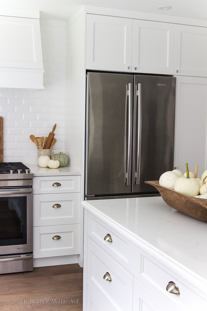 white kitchen, white quartz countertop, white pumpkins- Fall Kitchen Tour