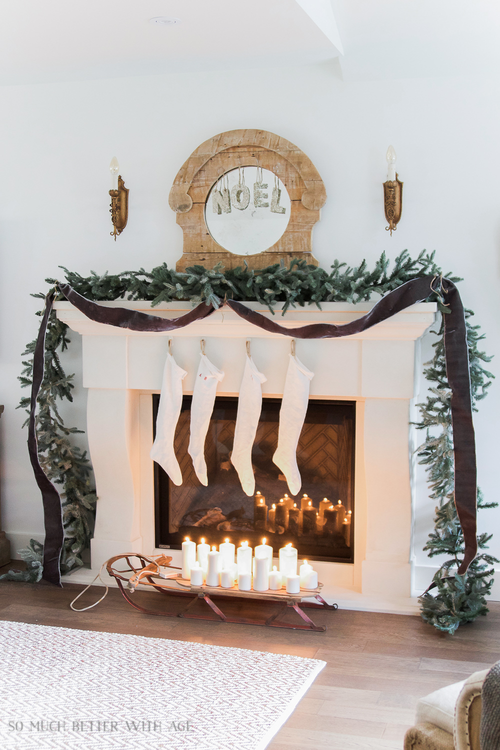 Fireplace mantel with green garland, French stockings - Christmas Mantel 2016