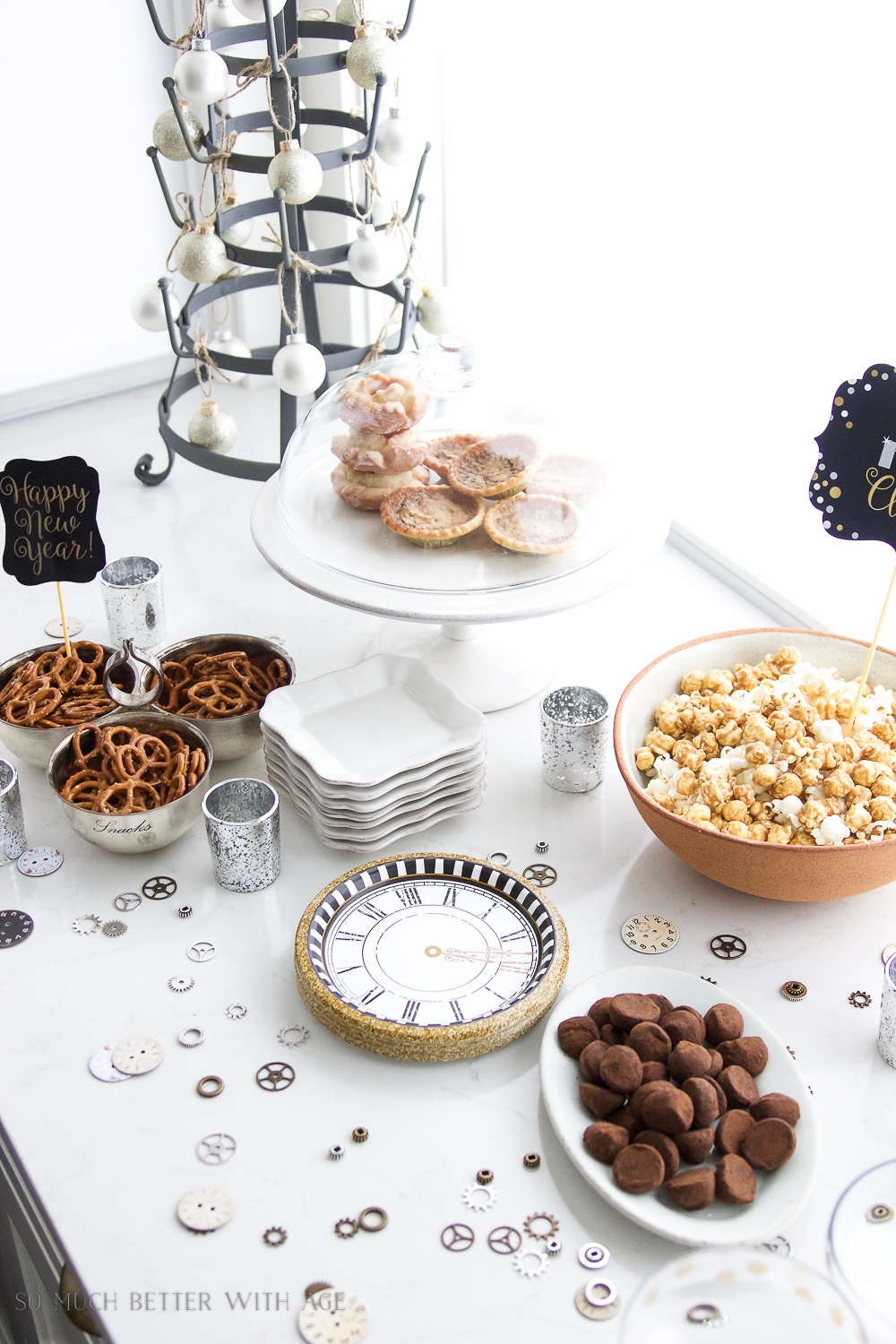 A New Year's Eve Party Bubbly Bar with Party Tips / pretzels and baked goods on table - So Much Better With Age