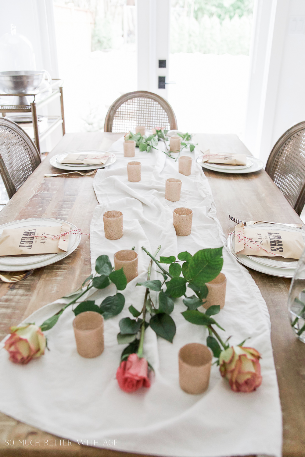 How to Set a Beautiful Valentine's Day Table Setting, a step-by-step guide / roses lying on table - So Much Better With Age