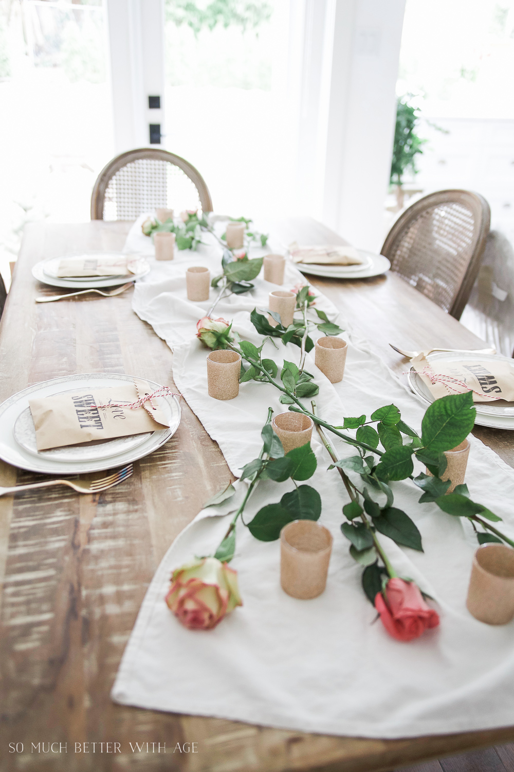 How to Set a Beautiful Valentine's Day Table Setting, a step-by-step guide / scattered roses on table - So Much Better With Age