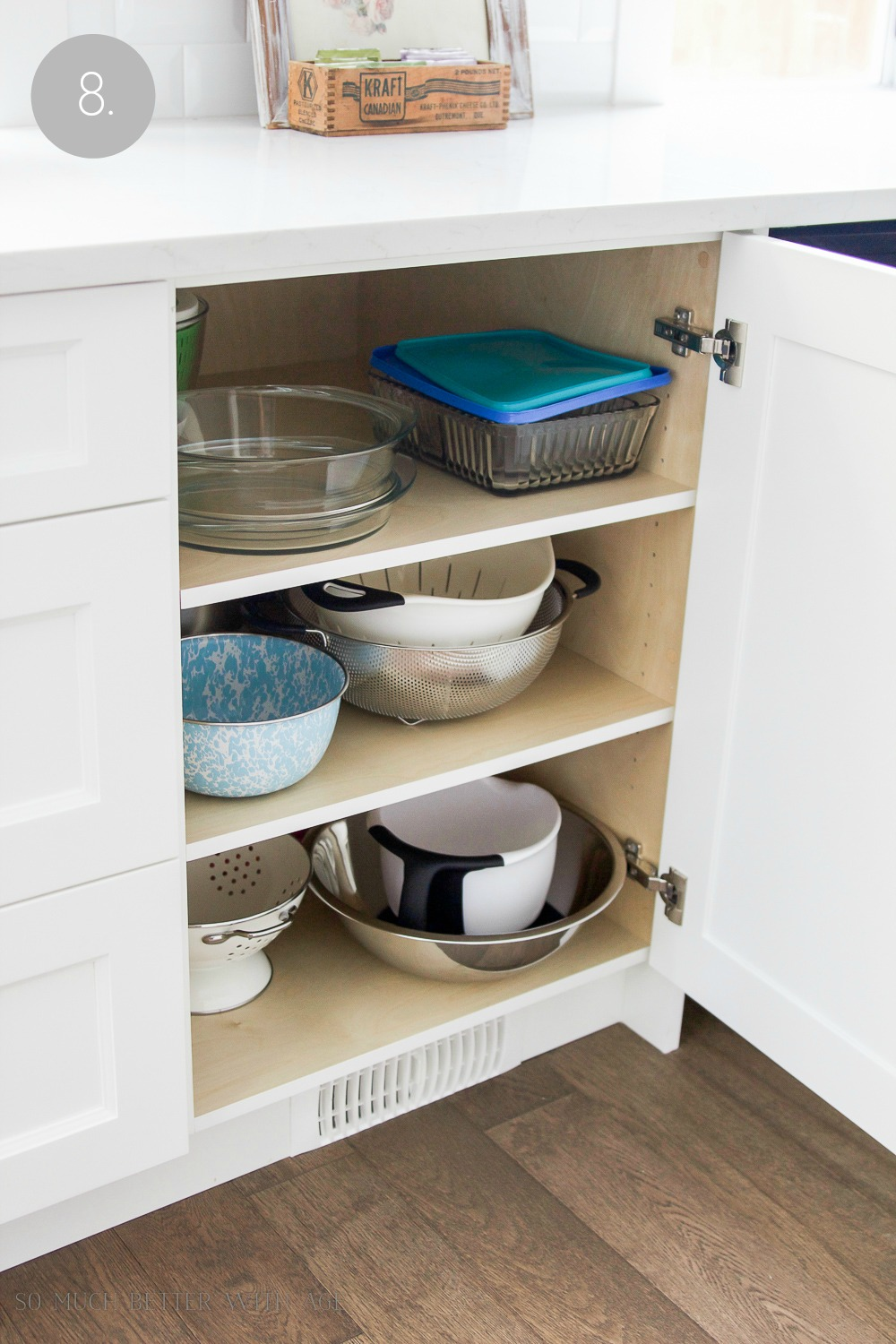 Kitchen cupboard and drawer organization / organizing the baking bowls in cupboard - So Much Better With Age