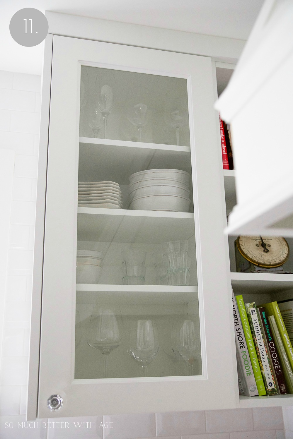 Kitchen cupboard and drawer organization / wine glasses and plates organized in cupboard - So Much Better With Age