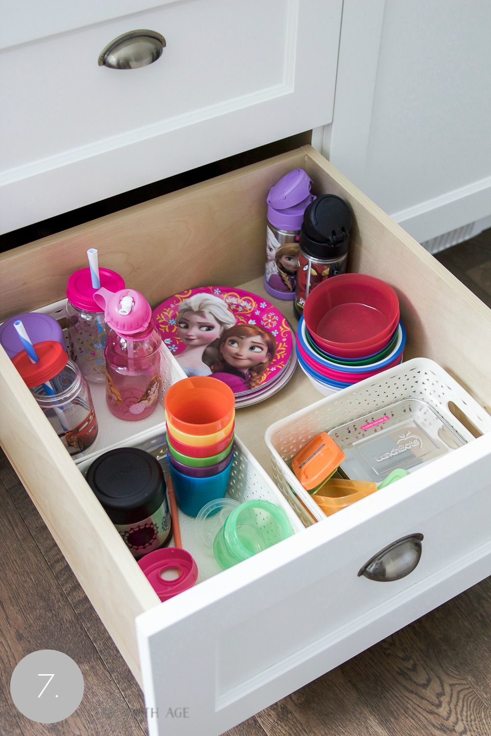 Kitchen cupboard and drawer organization / organizing the kids plates and cups in drawer - So Much Better With Age