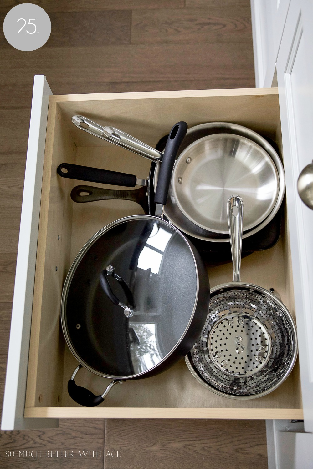 Kitchen cupboard and drawer organization / wok and strainer in drawers - So Much Better With Age