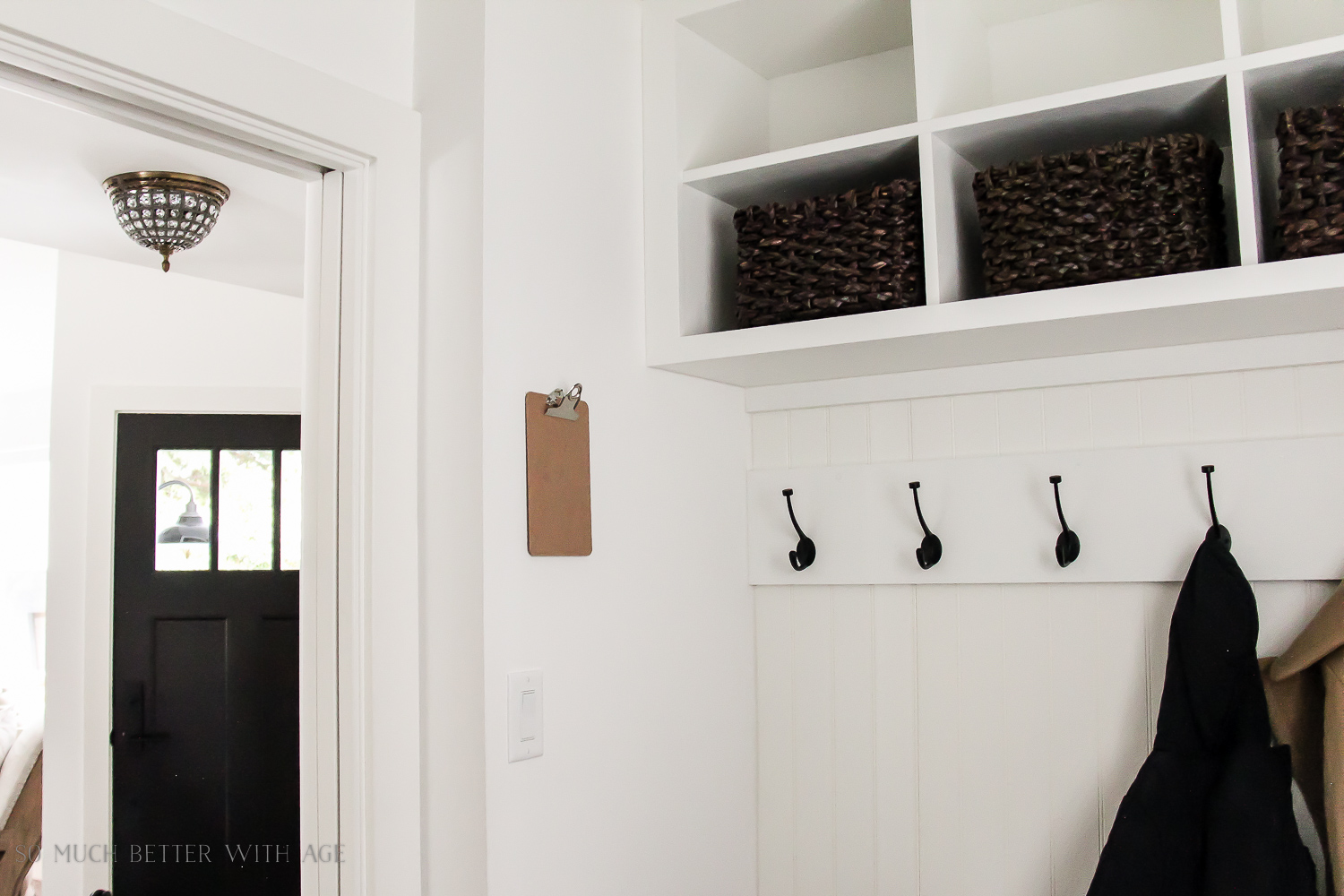 Tiny Vintage Mudroom Makeover / black hooks and cubbies in laundry room- So Much Better With Age