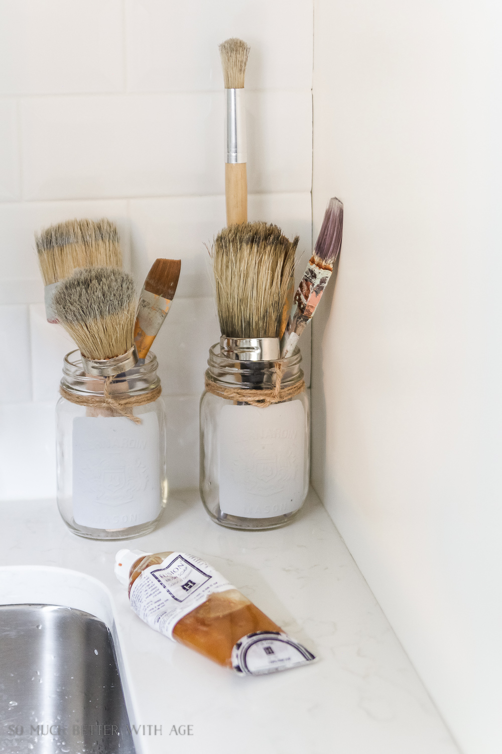 Tiny Vintage Mudroom Makeover / painted mason jars storing paint brushes - So Much Better With Age