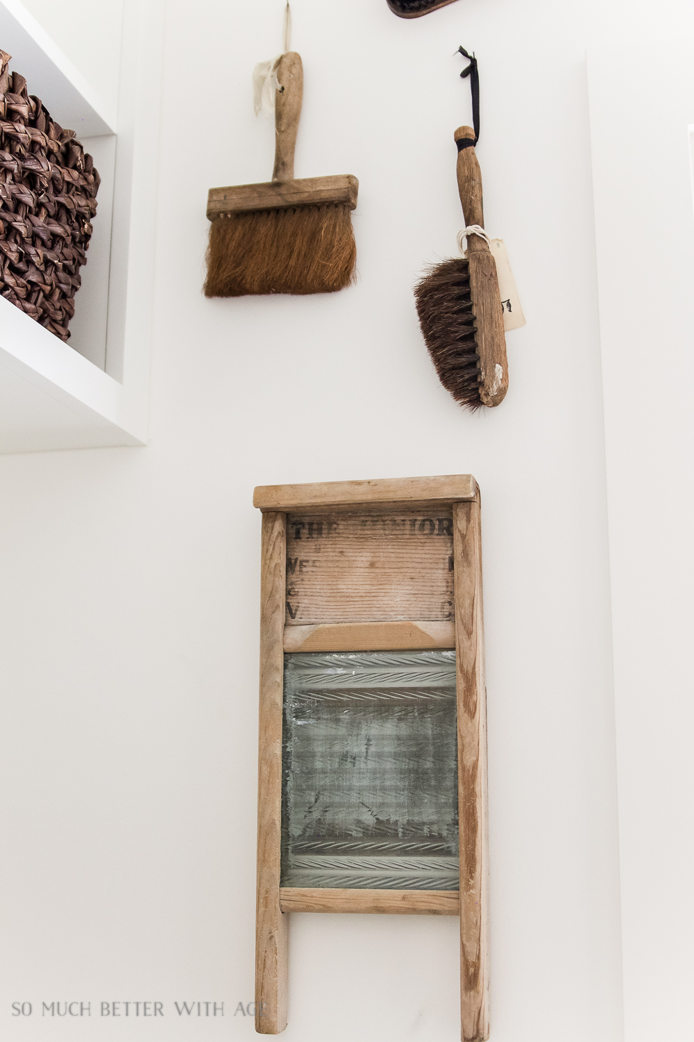 Tiny Vintage Mudroom Makeover / vintage washboard hanging on wall - So Much Better With Age