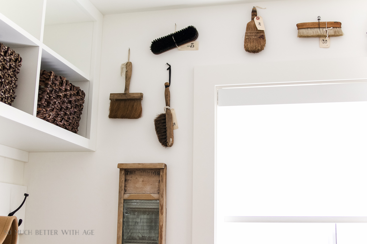Tiny Vintage Mudroom Makeover / vintage paintbrushes hanging on wall - So Much Better With Age