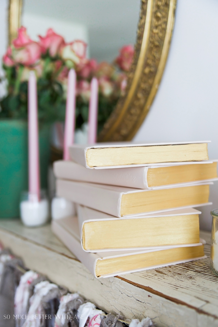 The stacked books on the wooden table.