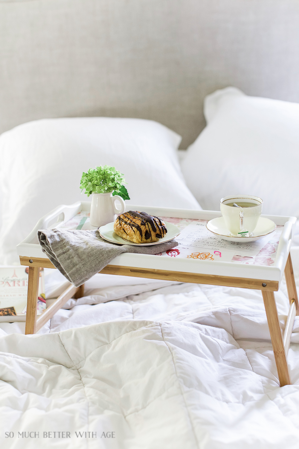 Mother's Day breakfast-in-bed tray with decoupaged kids' art / tray on bed with flowers tea and croissant - So Much Better With Age