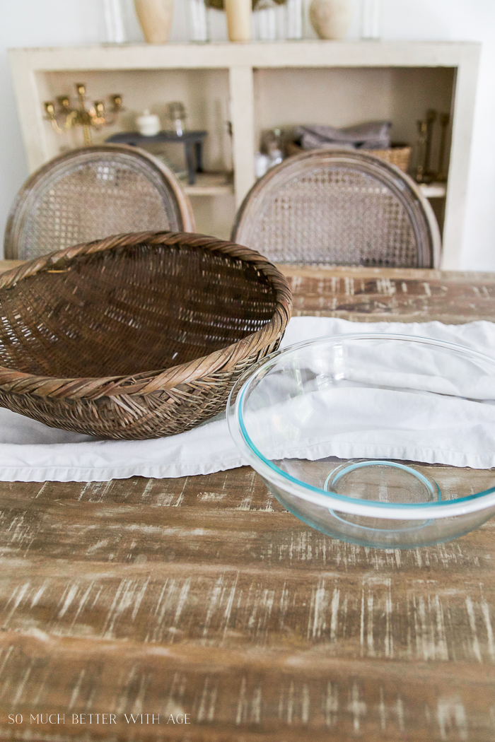 Basket and bowls on table.