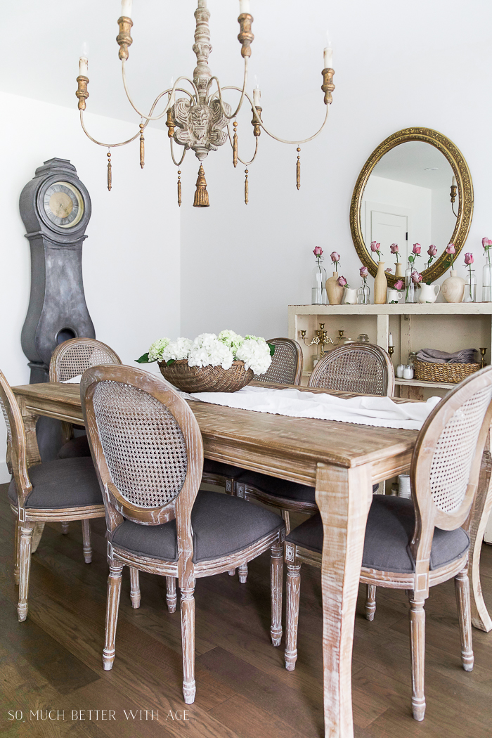 Dining table with chandelier above it.