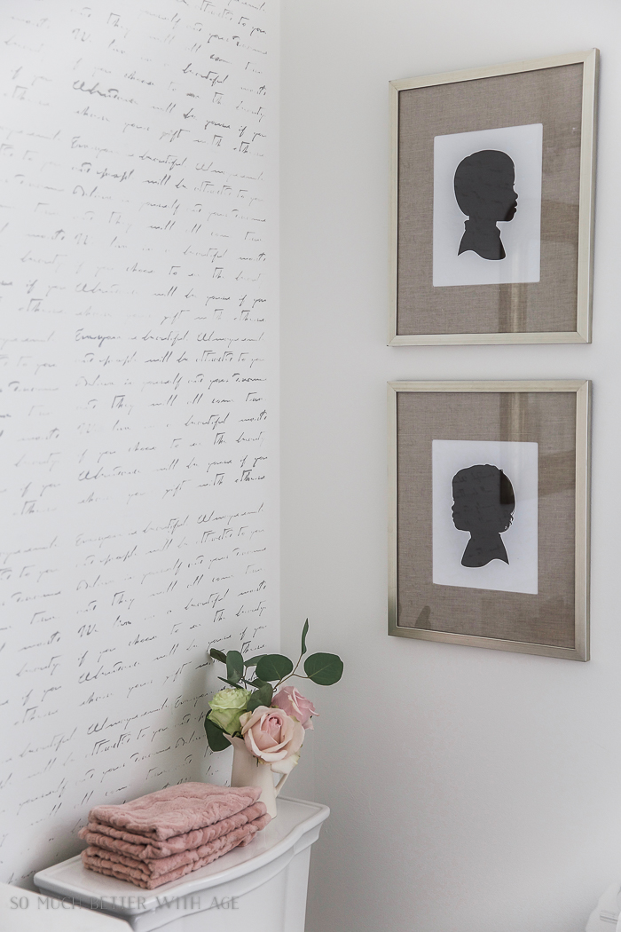 Black white french bathroom makeover/ framed silhouettes, flowers in vase - So Much Better With Age