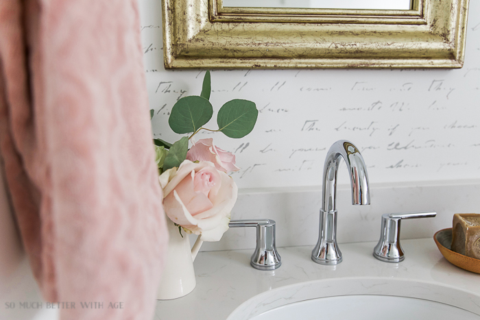 Black white french bathroom makeover / Delta Trinsic faucet, blush pink roses - So Much Better With Age