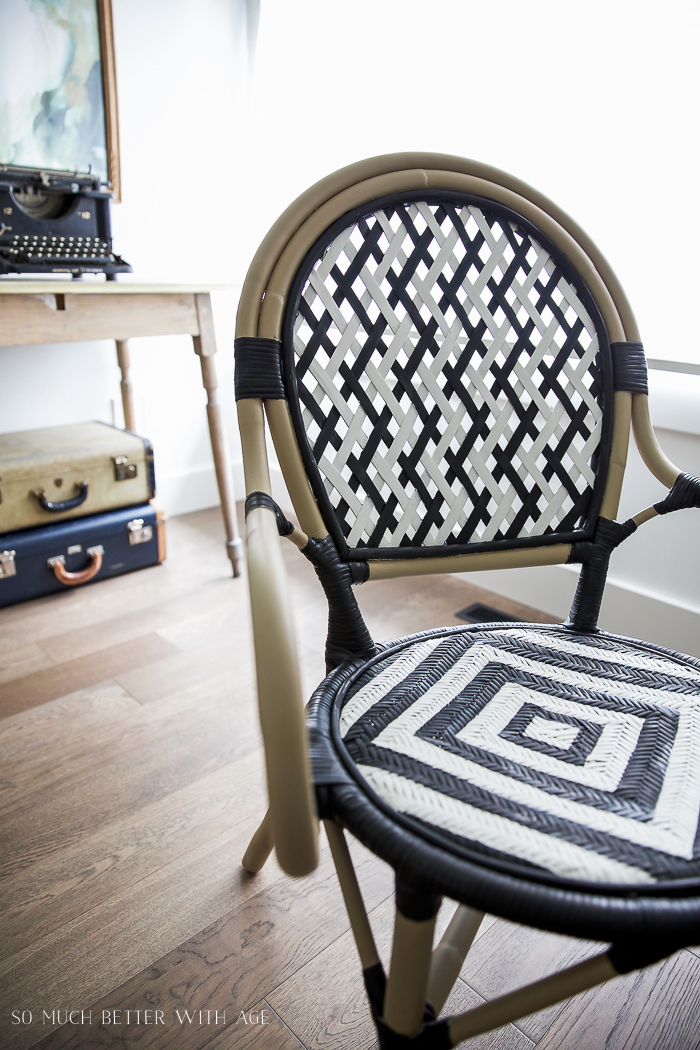 DIY French Bistro Chair/ black and white ikea chair, vintage typewriter, vintage suitcases - So Much Better With Age #frenchdecor #frenchvintage
