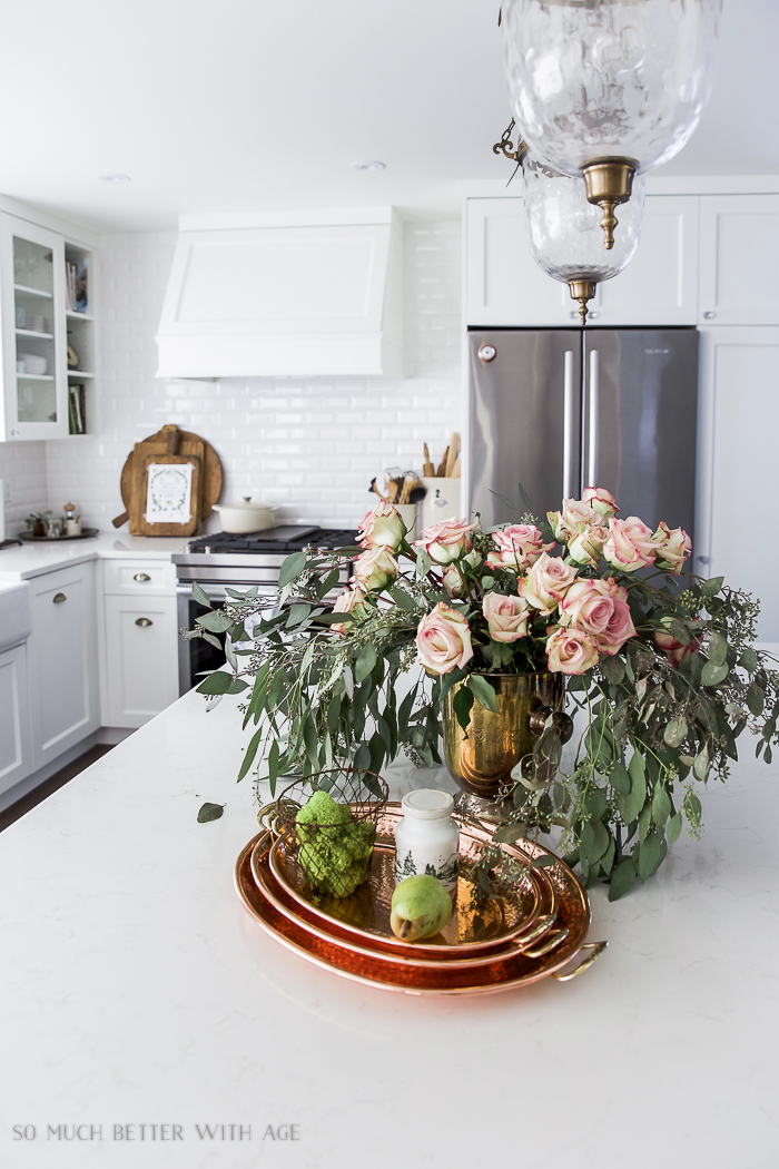 Roses and eucalyptus on the counter in kitchen.