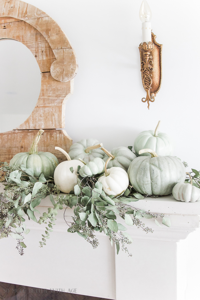 Heirloom pumpkins, and eucalyptus on the mantel.