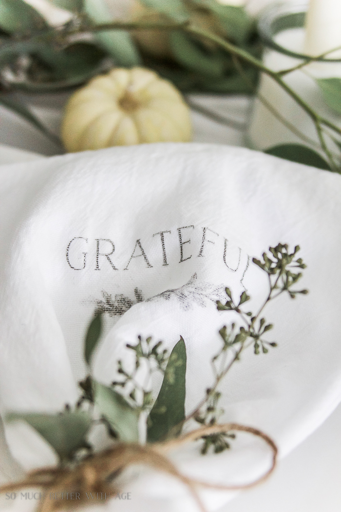 Grateful napkins on table setting.