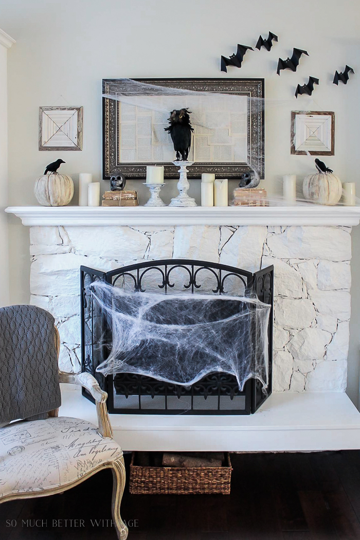 Fireplace with a spider web wrapped around the front of it.