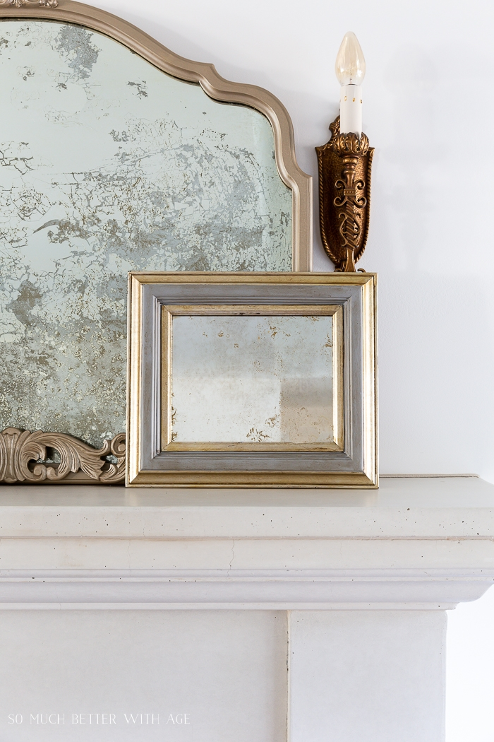 Gold mirrors and bronze wall sconce.