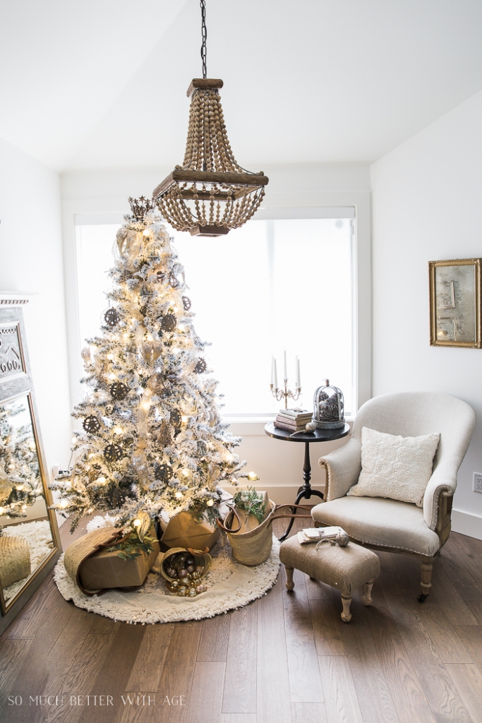 Wooden beaded chandelier in living room above the gold Christmas tree.