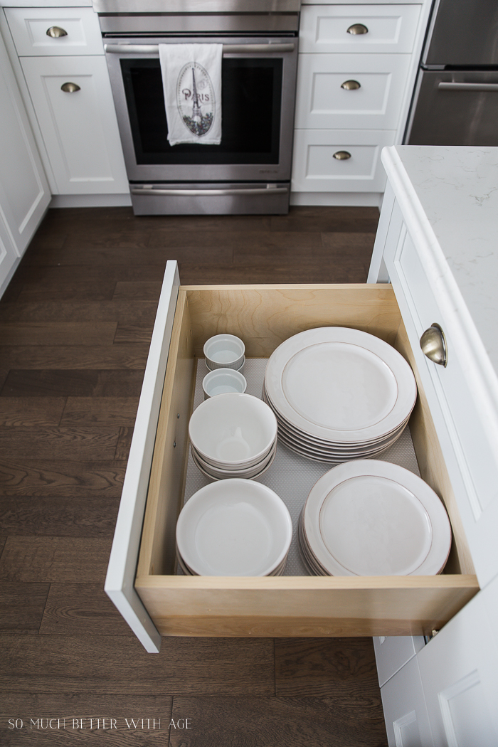 Complete Kitchen Supply List/white plates and bowls in kitchen drawer- So Much Better With Age