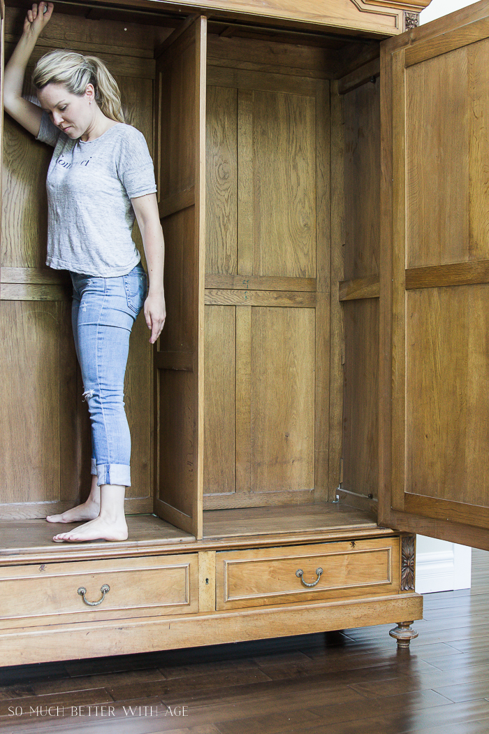 How to Decide Whether or Not to Give Antique Furniture a Makeover/standing in armoire - So Much Better With Age