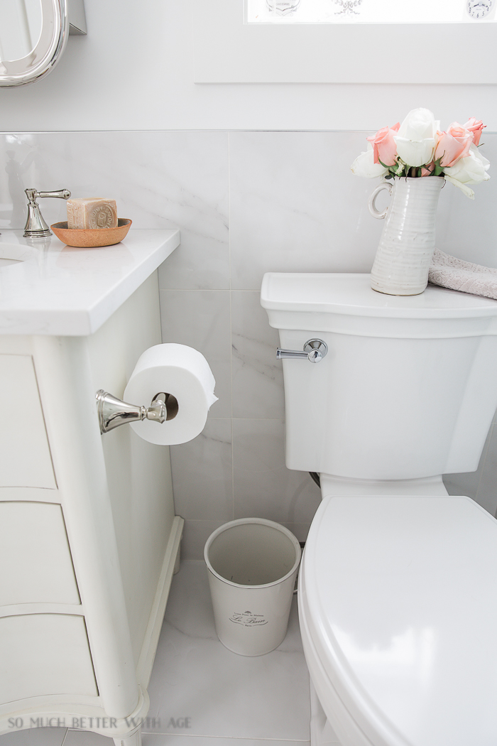 Faux Carrara Marble Porcelain Tile/tile behind toilet - So Much Better With Age