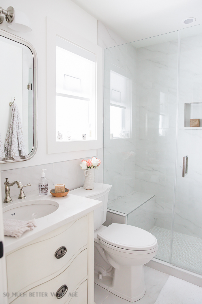 Small bathroom renovation and 13 tips to make it feel luxurious/white marble bathroom - So Much Better With Age