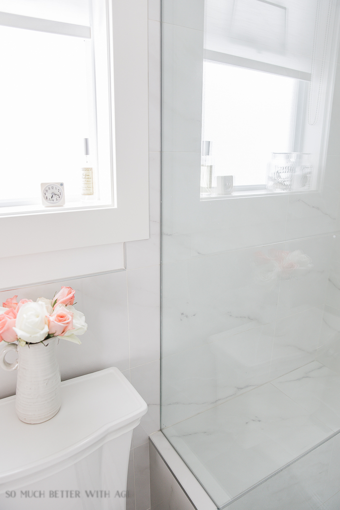 Faux Carrara Marble Porcelain Tile/tile goes from shower to behind toilet - So Much Better With Age